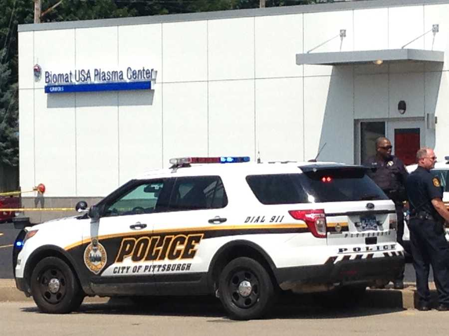 Two men who were shot in Manchester stumbled into the Biomat USA plasma center on Western Avenue.