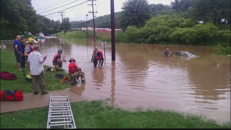 A woman had to be rescued from her car Sunday because of flooding on Old William Penn Highway near the intersection with Beatty Road.