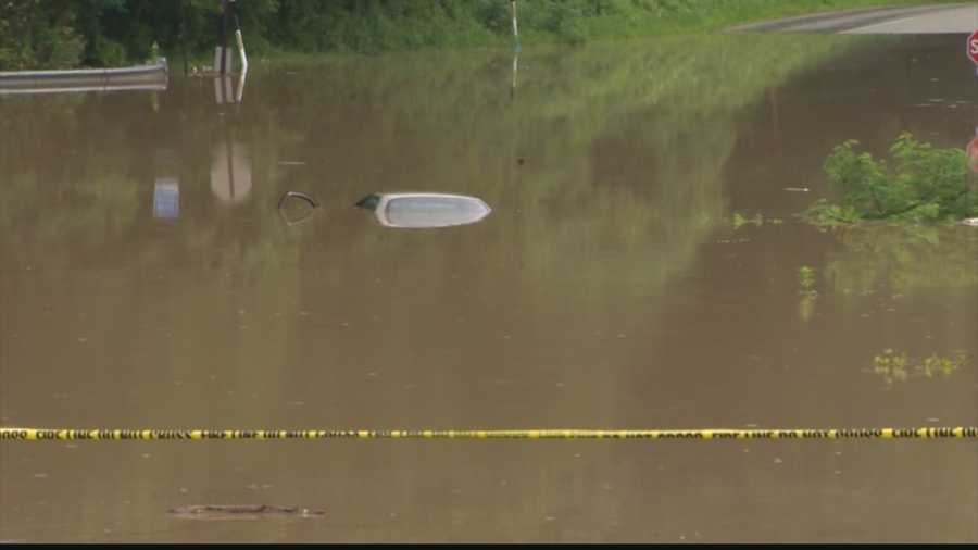But this is how it looked on Sunday morning, when a woman's car was submerged in flood waters. (That's the top of her vehicle in the middle of the picture.)