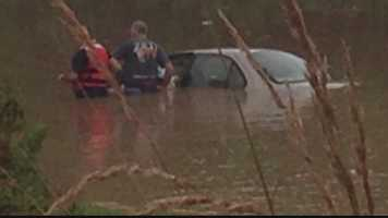 Monroeville firefighters were called to rescue the woman from her flooded car.