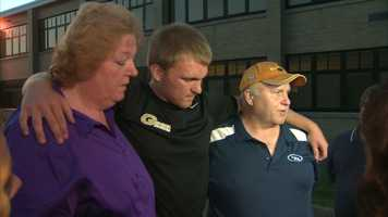 Noah Cornuet's older brother, Shane, with his mother, Pam, and father, Ray.