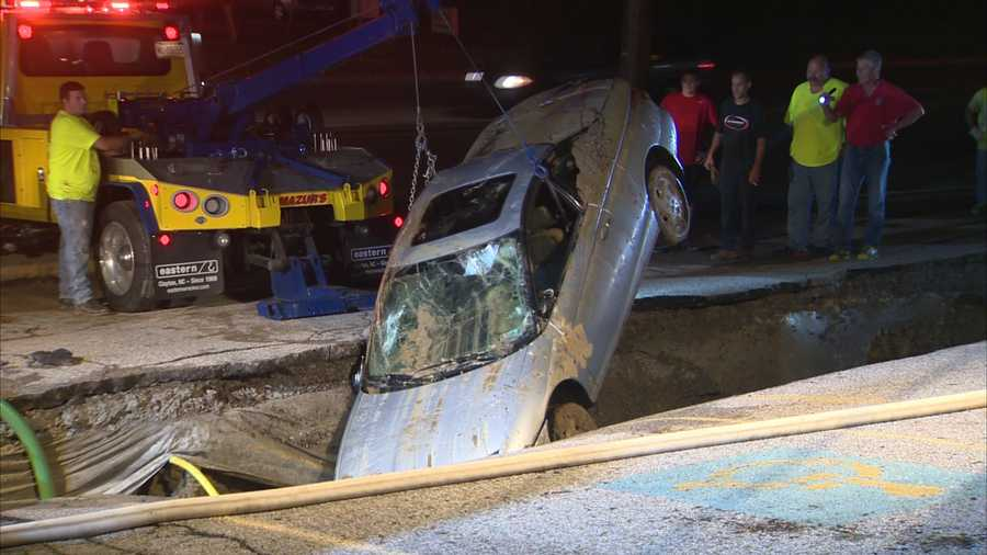 A sinkhole swallowed a car that was in the parking lot of Hollywood Tans on McKnight Road. The owner of the business helped rescue the driver before the entire vehicle vanished underwater in the expanding hole.