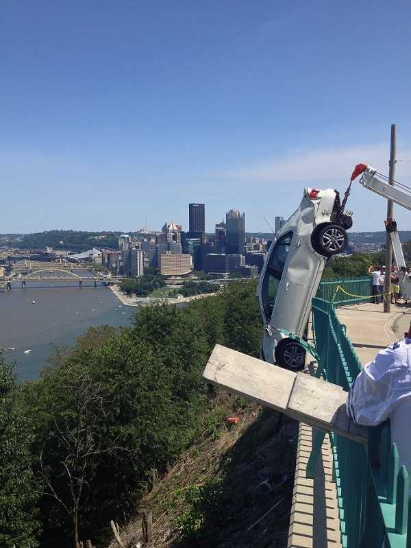 What a picture: The beauty of the Pittsburgh skyline, and the danger of a car dangling over Mount Washington.