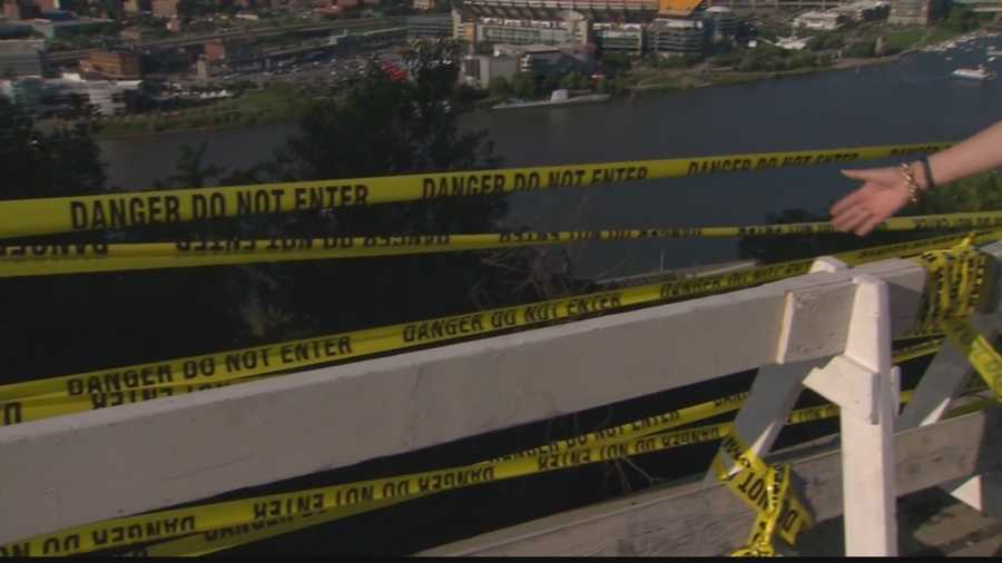 Pittsburgh police used yellow tape and a temporary barricade to mark the area where a section of the fence on Grandview Avenue is now missing.