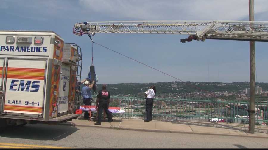 Emergency responders used ropes and a pulley to bring the man up the hillside to safety.