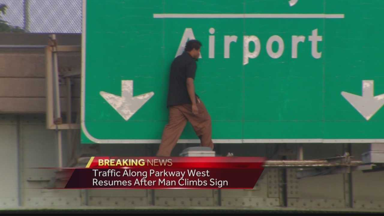 The outbound lanes of Interstate 376 in Green Tree were shut down while authorities tried to talk a man off a highway sign.