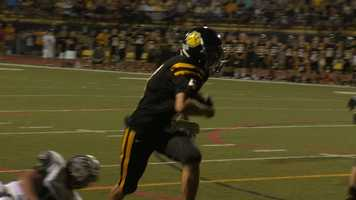 North Allegheny's Clay Byerly scores for the Tigers.