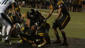 Quarterback Jeff Clemens takes it in for a North Allegheny touchdown.