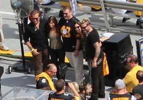 Country music artists, Gloriana, pose with fans before singing the National Anthem at today's game