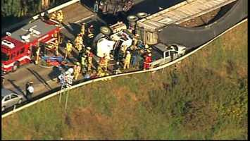 A tractor-trailer landed on a pickup truck in a rollover crash in Butler County.