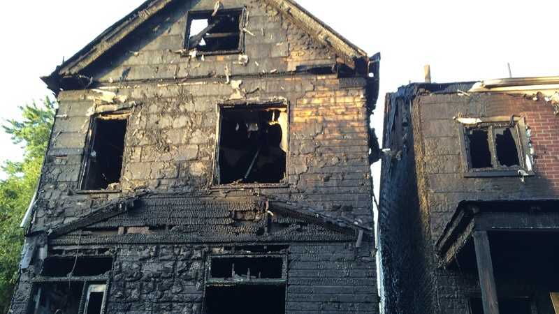 The fire started around 2:15 a.m. at a house on Orpwood Street and spread next door.