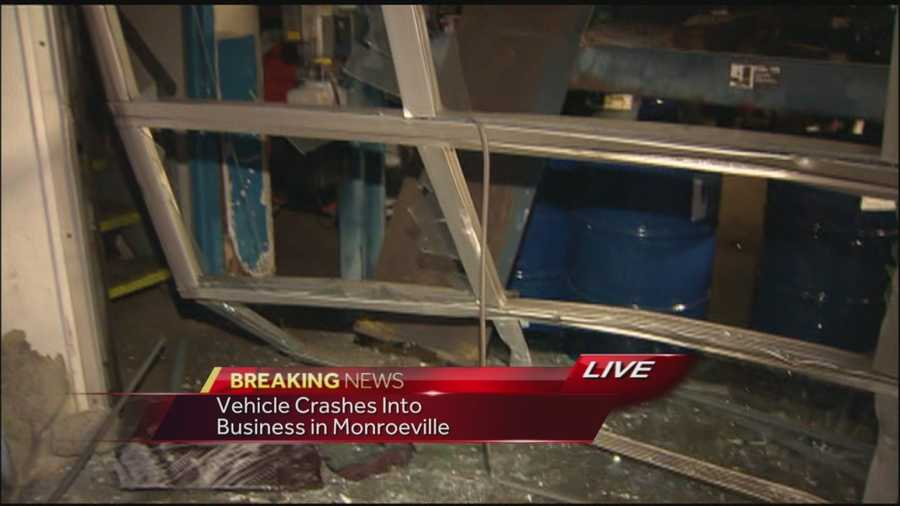 Police said the driver simply lost control when she backed up and drove into the garage. She was not injured.