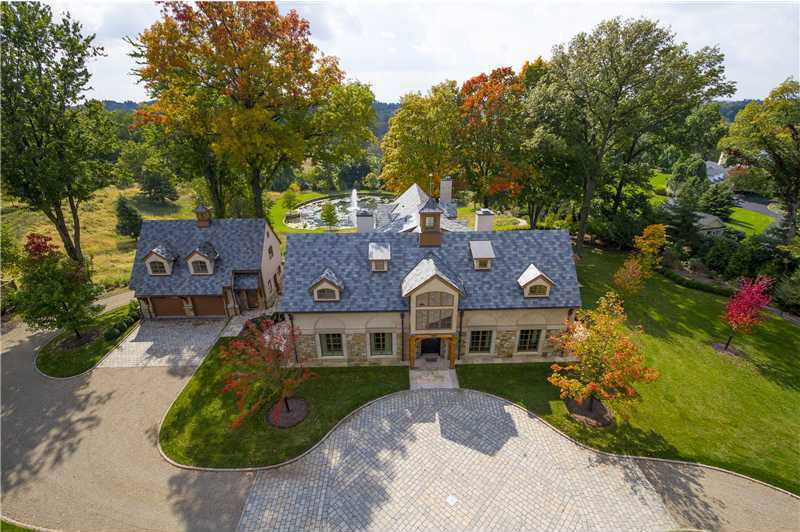 Location: 39 Timberhill Drive, Sewickley Heights, PAEnjoy estate living in this $3.8M Sewickley Heights home which includes four bedrooms, six bathrooms, and is situated on over 5 acres of land. The home includes custom finishes throughout and is featured on realtor.com.