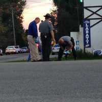 State police troopers examined evidence on the shoulder of Route 58.