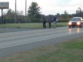 Police took photos of evidence on Route 58.