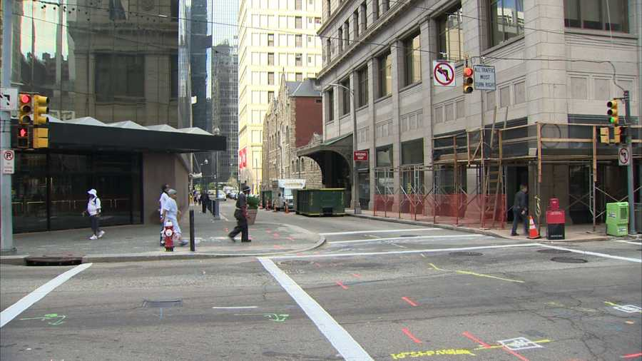 A year from now, the intersection of Smithfield Street and Oliver Avenue will look much different. The old Saks building will be gone -- replaced by storefront retail, with parking and apartments above it -- and the Oliver Building will be renovated.