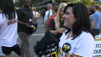 "Members of the ""Bucco Brigade"" passed out rally towels to Pirates fans in the crowd."