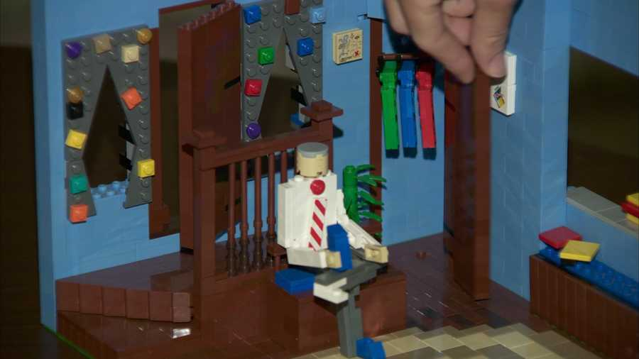 The closet door can swing open. Inside, there are little Mr. Rogers sweaters on hangers.