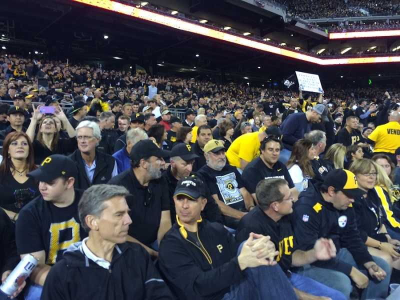 """Pirates fans dressed in black to create a """"blackout"""" at the NL Wild Card Game."""