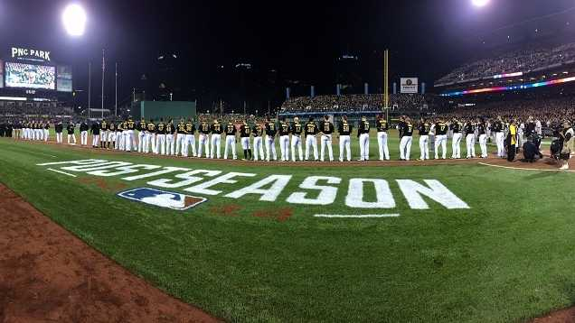 The Pirates line up for pregame ceremonies.