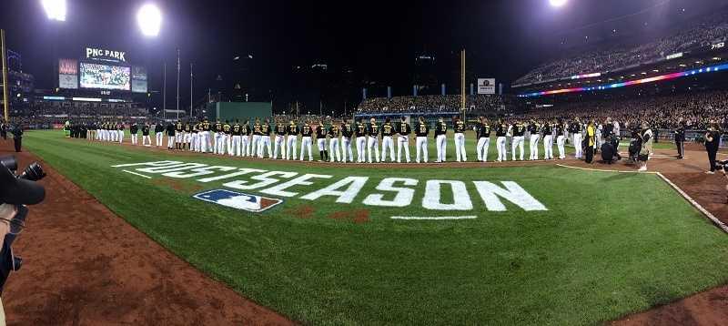The Pirates line up for pregame ceremonies.