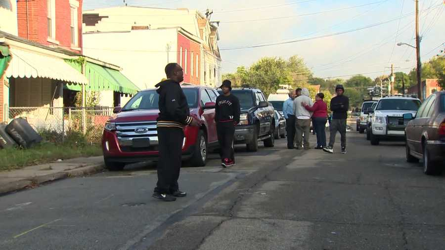 Family members gathered at the crime scene after the fatal shooting of 17-year-old Eric Young.