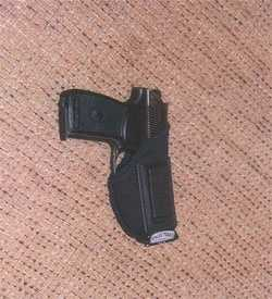 This gun was seized after a search warrant was executed at the suspects' home on Ross Avenue.