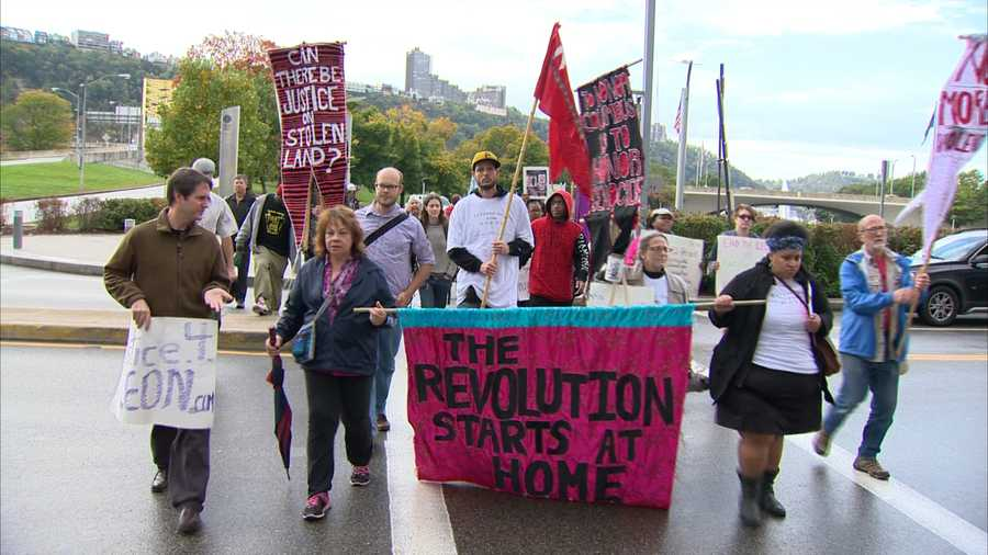 The Columbus Day protest march began Monday morning at the entrance to Point State Park in downtown Pittsburgh.