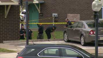 Police said two masked people chased the victims on foot and shot them before fleeing in a dark sedan.