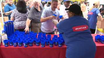 Cups of milk were poured for people to participate in the cookie-dunking world record attempt.