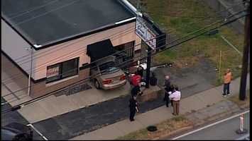 A car crashed into a Monroeville business that does eyebrow threading.