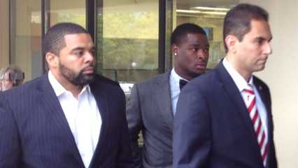 Le'Veon Bell walks into a district judge's courtroom.