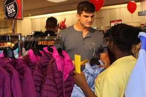 Rob Blanchflower helps his shopping buddy choose the perfect purple coat!