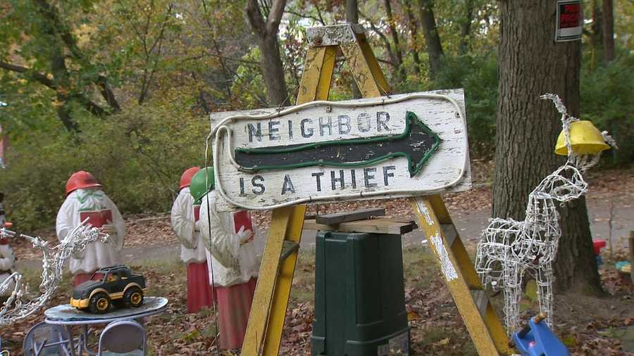 The display becomes personal when you view the handwritten signs that are hung on every angle of the house. The signs are vulgar, too vulgar to report verbatim. And the signs list neighbors by name.