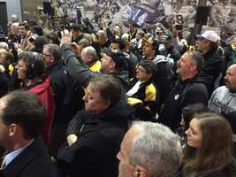 Steelers fans take pictures of Joe Greene as he gets his number retired. There is now a jersey retirement display at the Great Hall at Heinz Field.