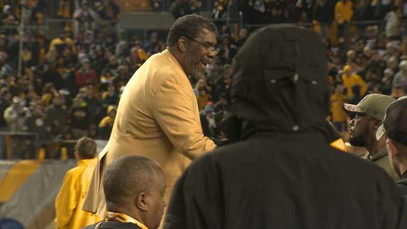 Steelers coach Mike Tomlin congratulates Joe Greene at his jersey retirement ceremony.