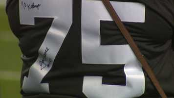 Signatures on Joe Greene's 75 jersey at his number retirement ceremony.