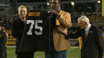 Steelers President Art Rooney II and his father, Dan, congratulated Joe Greene at a ceremony to retire the number 75 at Heinz Field.