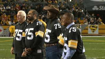 Former Steelers including Andy Russell, Franco Harris, Mel Blount and Lynn Swann wore No. 75 jerseys to honor Joe Greene at his number retirement ceremony,