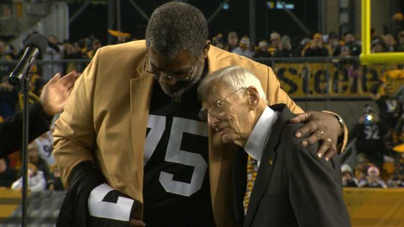 Joe Greene embraces Pittsburgh Steelers Chairman Dan Rooney during a ceremony to retire Greene's No. 75 jersey at Heinz Field.