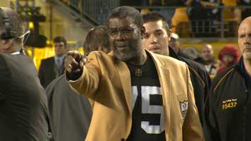 Joe Greene recognizes well-wishers during the ceremony to retire his Steelers jersey number.