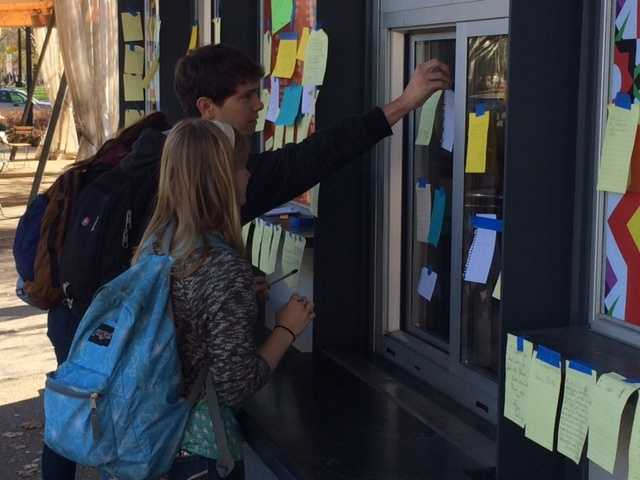 People have been writing letters of support and posting them on the window at Conflict Kitchen.