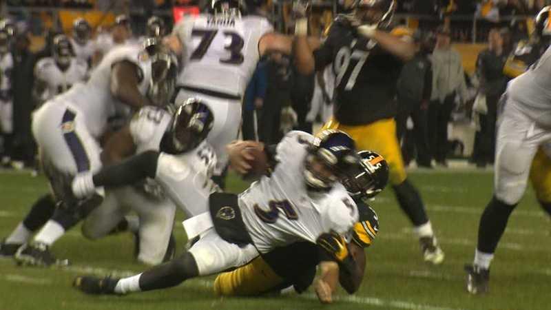 Baltimore quarterback Joe Flacco gets sacked by Arthur Moats.