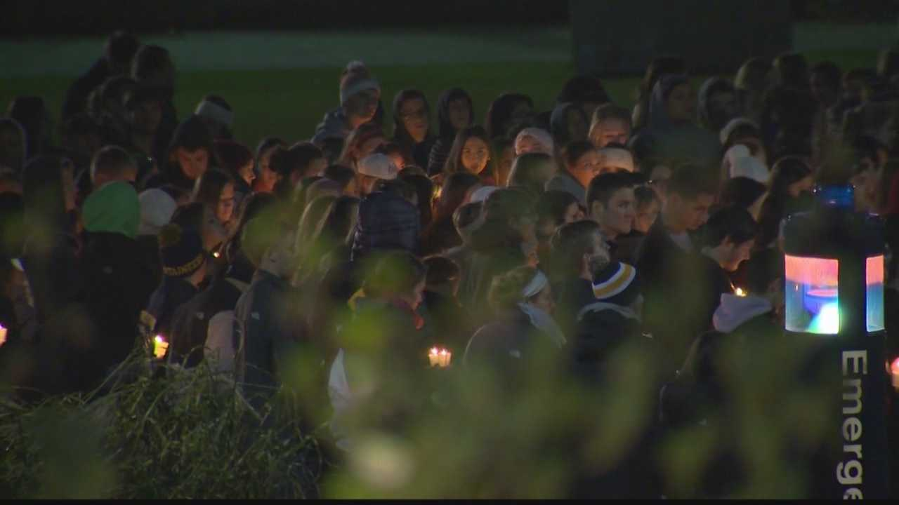West Virginia University students gather at a vigil to remember Nolan Burch.