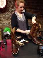 "Just bought my first pair of boots at ""Boot Barn"" in Nashville. Lisa getting them ready! impulsebuy @WTAE"