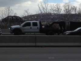A pickup truck hauling a trailer was pulled over after the crash on Route 28.