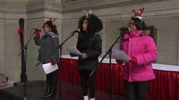 Holiday carolers perform on Light Up Night.