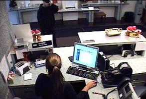 A robbery was reported Monday at First Commonwealth Bank in Dormont. These are surveillance images from the bank on West Liberty Avenue. Anyone with information about the robbery is asked to call police.