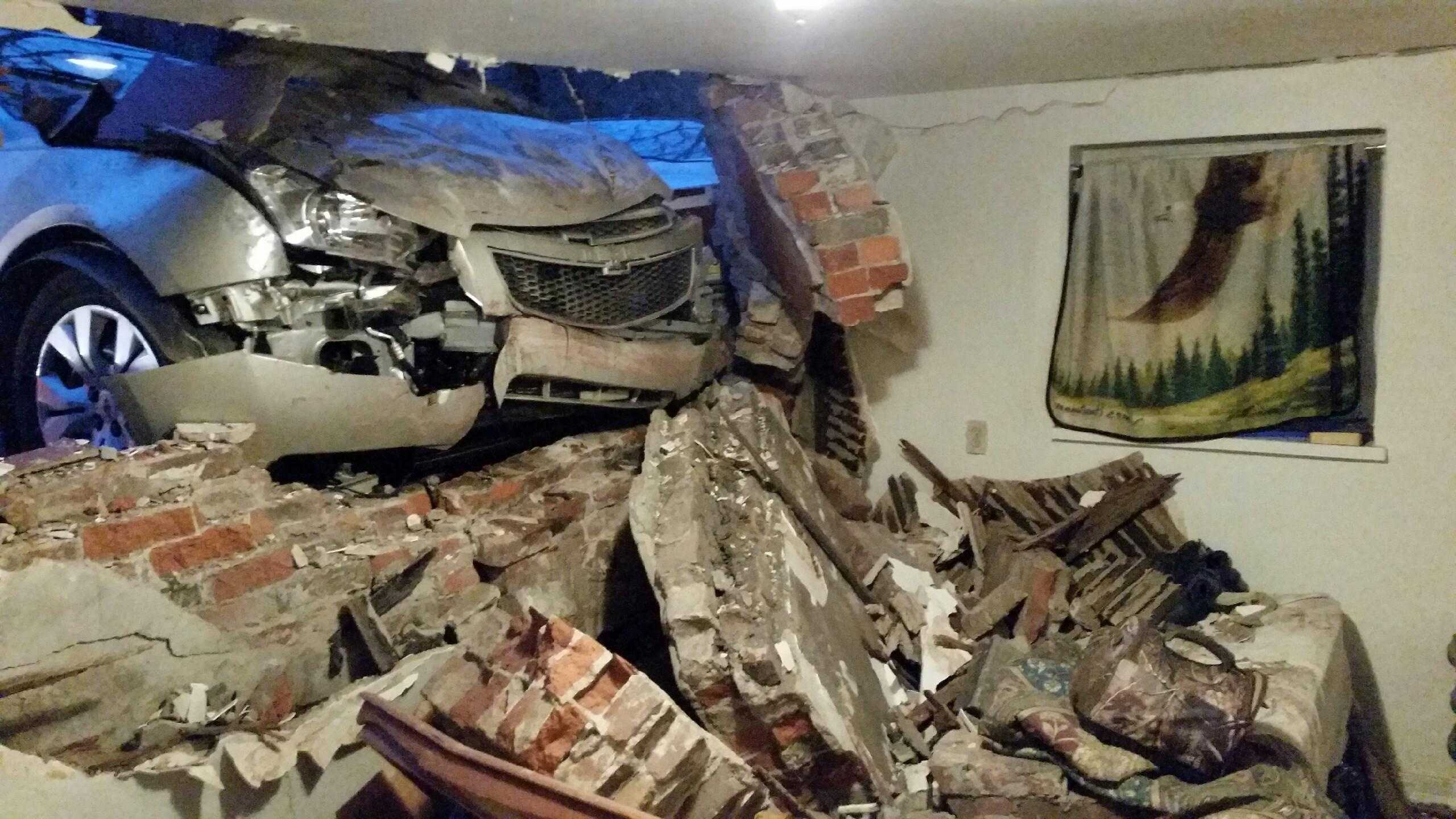 A car crashed into a house in Pittsburgh's Oakland neighborhood early Wednesday morning.