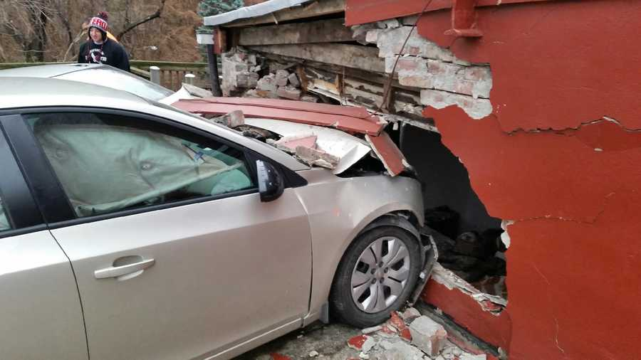 A man said he was asleep in his bed when a car crashed into the home on Bates Street around 3 a.m.